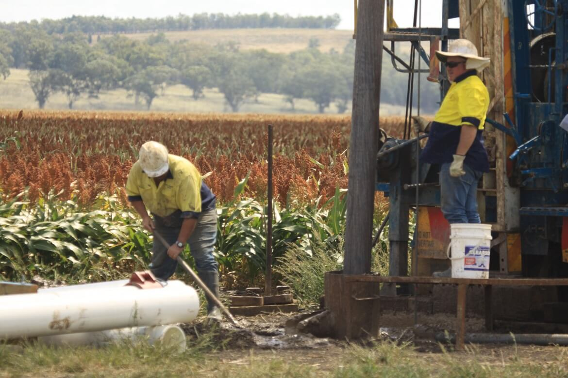 Two Water Resources Drilling workmen boring water in Dubbo.